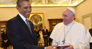 """Pope Francis and President Barack Obama smile as they exchange gifts, at the Vatican Thursday, March 27, 2014. President Barack Obama called himself a """"great admirer"""" of Pope Francis as he sat down at the Vatican Thursday with the pontiff he considers a kindred spirit on issues of economic inequality. Their historic first meeting comes as Obama's administration and the church remain deeply split on issues of abortion and contraception. (AP Photo/Gabriel Bouys, Pool)"""
